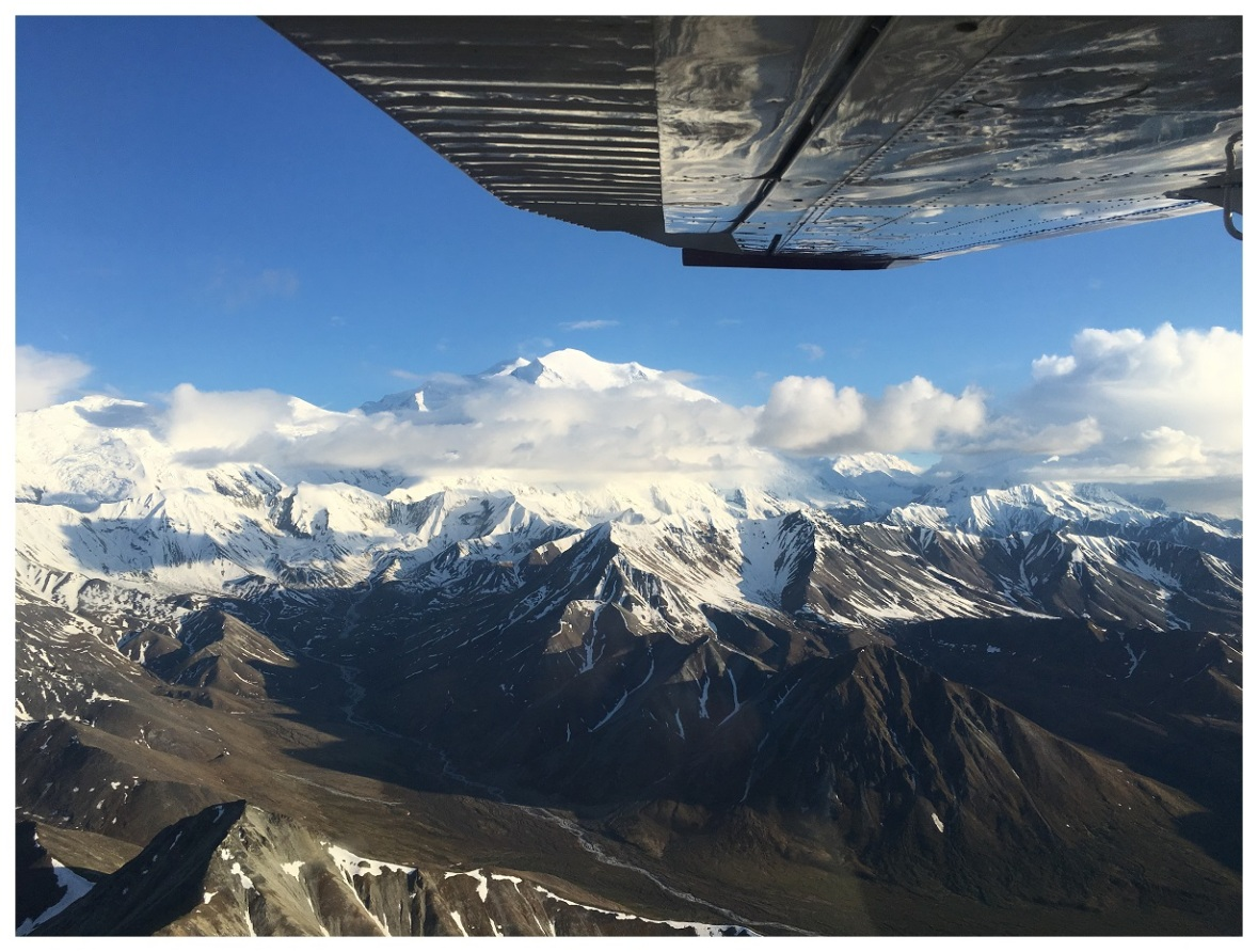 plane aviation mountain sky clouds denali