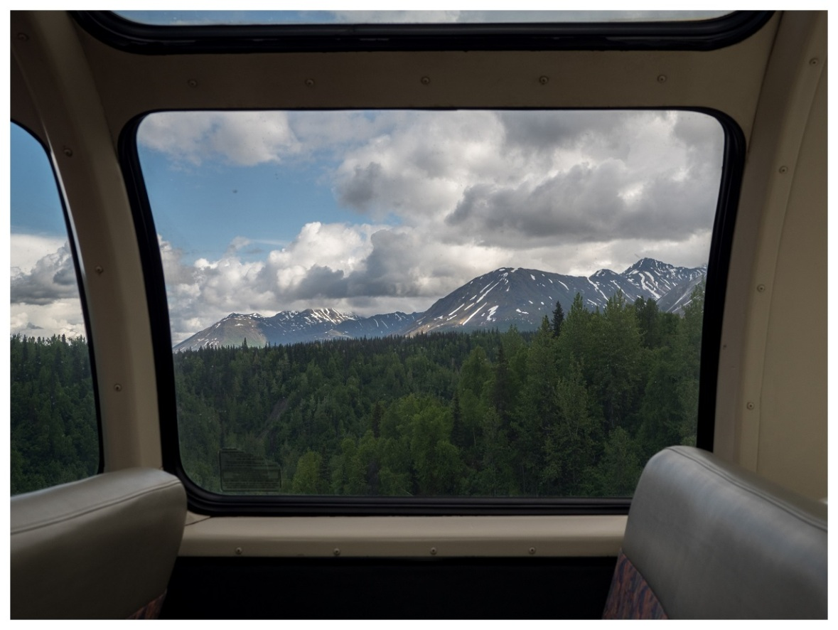 A view from the side of the dome car, coming into the train station for Denali National Park.